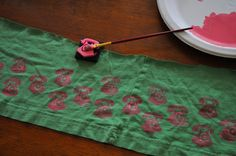 Super-great tip for upcycled tee items: if you can't find enough interesting tees, stamp on them with funky stamps and fabric paint.  Her result is pretty cute!