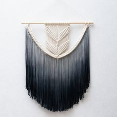 ● D E S C R I P T I O N  This gorgeous macrame wall hanging is handmade with neutral and hand-dyed cotton macrame cord. You can choose the following dying colors in the drop-down menu:  - Ash Grey - Dark Grey - Navy Blue - Olive green  Please contact me if youd like to have your wall hanging dyed in another color.    ● D I M E N S I O N S This macrame wall hanging measures:  Dowel length: 20 inches ( 50 cm ) Macrame height: 27.5 inches ( 70 cm )    ● S H I P P I N G  This item is made to…