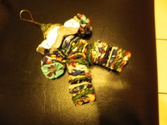 This is a clown made out of pompoms and   on thin elastic.