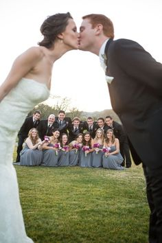 Love this shot! Great wedding photo idea with bridal party in the back. Adorable. by Katellerts