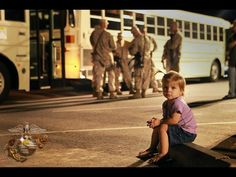 Don't Go, Daddy    Kaydence Hoversten, 22-month-old daughter of Gunnery Sgt. Jared Hoversten, sits in front of buses shortly before her dad and other Regimental Combat Team 7, 7th Marines leave for their deployment to Afghanistan Oct. 9 at 7th Marine Regimental Headquarters. RCT-7 is departing for Helmand province, Afghanistan, where they will be taking over as the senior ground combat element in the area.