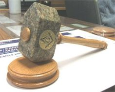 In speculative Freemasonry, the Masonic Gavel is used to symbolically divest the heart and consciousness of all the vices and superfluities (excesses) of life in order to ready ourselves as if we were living stones, open to be shaped into a spiritual being that is pleasing to our Creator.