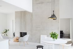Keeping room fireplace - tile similar to this one, but fireplace design much different and with a wood floating mantle above Photo | Marja Wickman