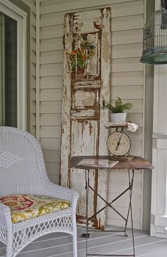Porch decor - wicker, shutter, birdcage.  Chateau Chic