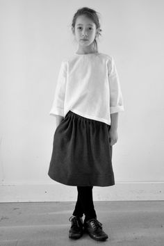 all the elements of a timeless outfit -white blouse, black gathered skirt, brogues.