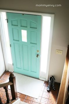 How to Paint your front door! It's an easy and inexpensive way to update your entryway. | www.mommyenvy.com