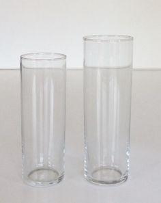 Bicchieri alti in vetro. H.cm.15x5.disponibili 18 pezzi. H.cm.18x6.disponibili 12 pezzi.