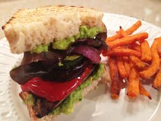 Mile high grilled veggie sandwich with roasted garlic avocado spread :) 300 calories and so tasty!
