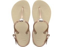 <p>The Freedom Sandal features colorful embellishment and an adjustable metallic slingback strap for a fun, fashionable look and secure fit. The injected, molded sole provides added comfort with our signature textured footbed.</p><ul>  <li>Thong style with slingback strap</li>  <li>Cushioned footbed with textured rice pattern and rubber flip flop sole</li>  <li>Made in Brazil</li></ul>