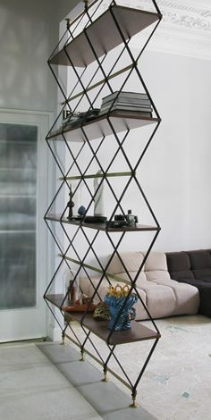 Very cool custom metal shelving and room divider.