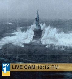 "Pretty amazing photo of The Statue of Liberty during ""Hurricane Sandy"""