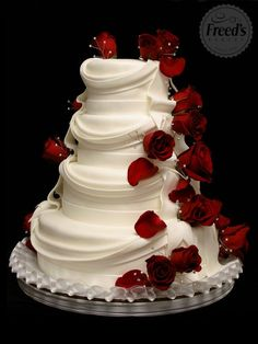 Ivory or white layered tiered wedding cake with red roses and drapery – Cake by Freeds Bakery Las Vegas