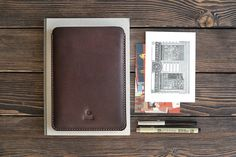 Handmade leather iPad mini sleeve. Dark brown color. Cut, pierced and sewn by hand. Your initials or other information can be added with stamping method. SIZES: W*H 134*200 mm, (5,2*7,8 in) Genuine leather, 2 mm, waxed thread. What makes this case so great? – protection of your iPad from scrtatches, – minimalistic design, – neat handwork, – lasting and smooth to touch leather. TREATMENT: with colourless leather cream or colourless spray. The colour will darken a bit with time in case of...
