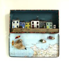 Cornish coastal scene in a vintage tin