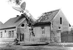 A Heinkel He-111H bomber from the German flying school Flugzeugfuhrerschule C12 is seen after it crashed onto a Czech house in the vicinity of Prague.