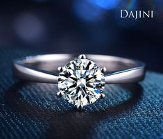 14K White Gold Solitaire Engagement Ring with a classic 6 Prong Setting. 1.5 carat round cut moissanite as the center stone. #engagementring #jewelry