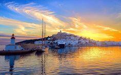 Ibiza port with Dalt Vila on the sun horizon☮