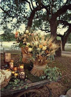 Here is an idea for floral arrangements. Branches, acorns and fall leaves.