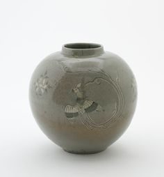 Jar with inlaid design of three phoenixes | first half of 13th century | Goryeo period | Stoneware with white and black inlays and black painting under celadon glaze | Korea | Gift of Charles Lang Freer F1907.367