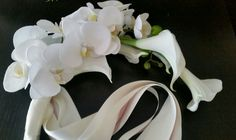 cascading phalaenopsis orchid and calla bouquet for the maid of honor; design by Davis Floral