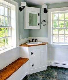 corner vanity provides open space for inward opening door and extra space from toilet