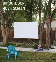 Our rental has three large trees off the lawn, and we decided it would be great to make an outdoor movie theater out there for our family to enjoy summer night movies.  It was pretty easy and we've be