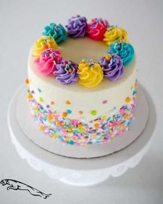 A rainbow cake is fun to look at and eat and a lot easier to make than you might think. Here's a step-by-step guide for how to make a rainbow birthday cake. Pretty Cakes, Beautiful Cakes, Amazing Cakes, Stunningly Beautiful, Decoration Patisserie, Birthday Cake Girls, Colorful Birthday Cake, Birthday Fun, Cupcake Ideas Birthday