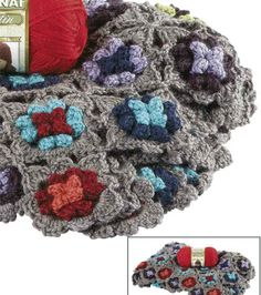 Love this crocheted rainbow flower afghan!  It looks so warm and cozy!