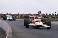 Jochen Rindt, Lotus 49 Ford ahead of Jackie Stewarts' Matra MS80 Ford, British GP, Silverstone 1969...