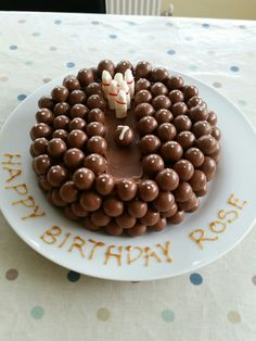Bowling cake with skittles made of milk bottle sweets and malteser bowling balls!