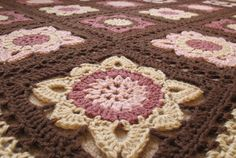 Beautiful blanket. Includes details of pattern and method of joining squares
