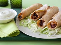 Chicken Flautas with Avocado Cream recipe from Sunny Anderson via Food Network. Roll up timesaving, spiced-up rotisserie chicken and cheese inside flour tortillas and fry for an easy, crispy summer appetizer best dunked in lime-spiked avocado cream. Mexican Dishes, Mexican Food Recipes, Ethnic Recipes, Mexican Appetizers, Dip Appetizers, Mexican Meals, Mexican Stuff, Mexican Night, Food Network Recipes
