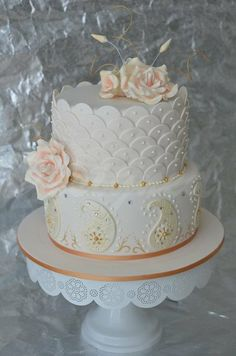 Special cake for your special day: gold and pink wedding cake.
