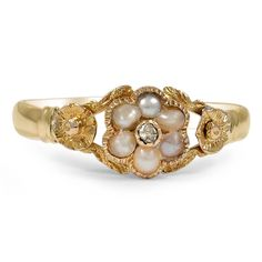If this were not in yellow gold I would love it! I like the small pearl flower =] (The Georgi Ring from Brilliant Earth)
