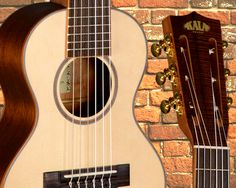 Woah, check this thing out, it's a guitar-ukulele hybrid! And it could be yours.  The Guitarlele is tuned to A-D-G-C-E-A, projects a bright full tone, similar to capoing up on the 5th fret of a guitar and has a list price of $429.99.