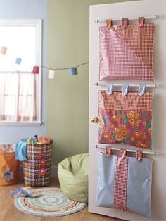 Hanging storage bags behind the door. Brilliant. The how-to doesn't seem to be online anymore but with curtain rod kits and some measuring I'm sure this can be duplicated.
