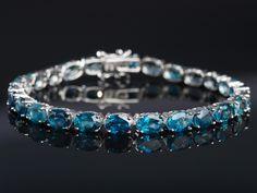 London Blue Topaz 23.00ctw Sterling Silver Tennis Bracelet. IN LOVE! London Blue Topaz is one of my faves!!