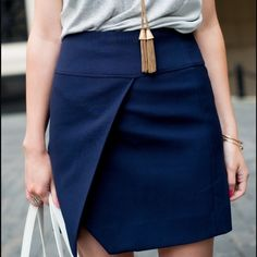 J. Crew Crossover Wrap Skirt Royal blue J. Crew Crossover Wrap Skirt. Sleek, clean lines with a faux front wrap makes this easy to dress up or down. Versatile: wear with tights in colder months and with sleeveless tops in spring/summer. Sits at the waist and falls above the knee. Poly/elastane with poly/viscose/elastane backing, exposed back zipper, lined. New with tags attached – in excellent condition. J. Crew Skirts Mini