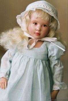 Emma is a vinyl Helen Kish doll (size 10.5 inches) repainted by Nancy Lee Moran. She wears a dress by Boneka.