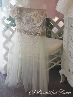 "This vintage inspired chair cover is a very popular rental for Brides that are hosting their reception at a vineyard, barn or other ""outdoorsy"" venue. It evokes a feeling of country romance but yet has a dramatic flair with the long multi-strand pearls. Bridal Shower Chair, Bridal Shower Rustic, Rustic Wedding, Wedding Ideas, Pearl Bridal Shower, Trendy Wedding, Wedding Chair Decorations, Wedding Chairs, Chair Cover Rentals"