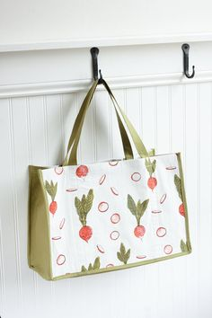 This fresh and pretty reusable marketing bag is just perfect for all your trips to the farmers market or the local grocery store. Featuring the humble radish, one of the first crops of springtime, this tote is sturdy and roomy. The handles are stitched into the bottom seam and reinforced