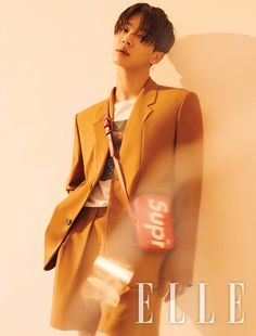 """Highlight member Lee Gikwang was featured in the September issue of Elle Magazine, where he talked about his solo album """"One."""" Along with a stylish pictori"""