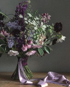 Bridal bouquet with lupins in lilac and lavender