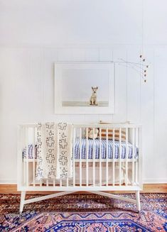 Design your newborn's unisex nursery with a global flair to keep the room bright, yet gender neutral.