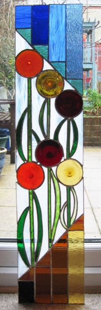 The first stained glass door panel completed.