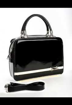 Aeroplane Bag in Black from PUG. @Faith Dery... i'm so in love with this bag, it's retarded!!!!