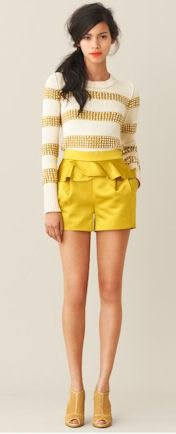 Adore these peplum shorts and gold striped sweater.