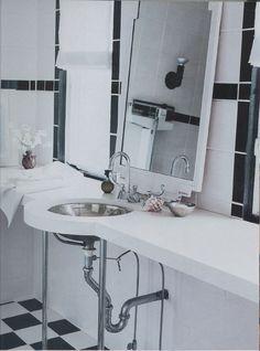 Curved countertop in powder room.  #contemporarybathroom