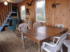 A small, off-grid home on the Patuxent River in Southern, Maryland. Small Houses, Maryland, Cabins, Grid, Conference Room, Southern, Dining Table, River, Furniture