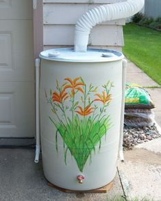 (Pb) Garden: Let it Rain! on Pinterest   @djohnisee ~ PIC:  *article no longer exits, only image* RAIN BARREL ~ DIY: My husband and I took a used 55-gal. plastic drum and made it into a rain barrel by cutting a hole into the top for the downspout and drilling a hole near the bottom for a faucet so we could attach a hose and water our garden with naturally soft (and free!) rain water. Because the barrel wasn't very attractive I painted it with flowers so it would blend in with our garden.